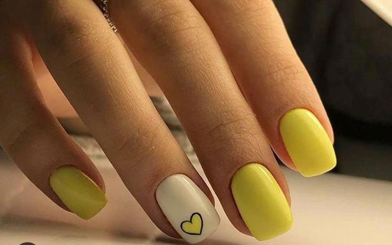 طراحی ناخن ساده زرد و سفید