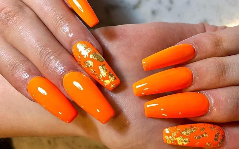 طرح ناخن نارنجی طلایی