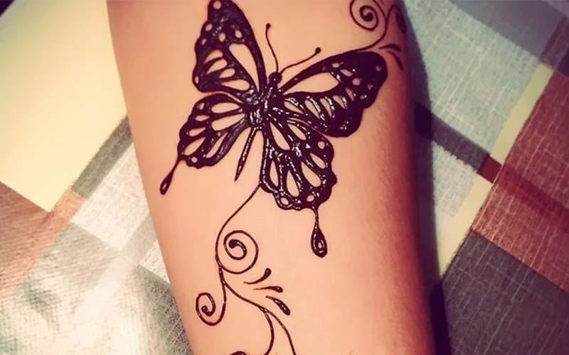 طرح پروانه روی ساق دست