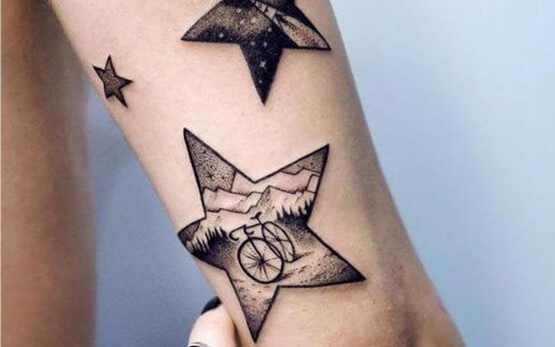 طرح تاتو ستاره با تصویر دوچرخه