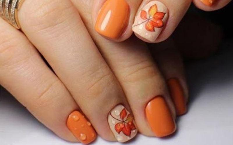 عکس ناخن پاییزی نارنجی کوتاه